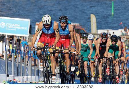 Spanish Triathlon Competitors Cycling Uphill