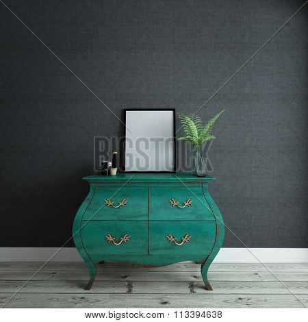 Stylish Green Dresser Drawers in Room with Gray Walls - Green Wardrobe with Picture Frame, Plant Vase and Knick Knacks in Sparsely Decorated Bedroom with Wood Floors and Copy Space