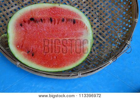 watermelon half cut on bamboo threshing basket