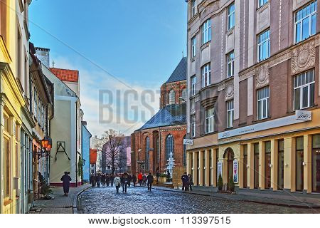 RIGA LATVIA - DECEMBER 25 2011: Street view to St Peter church in the Old city of Riga in Latvia