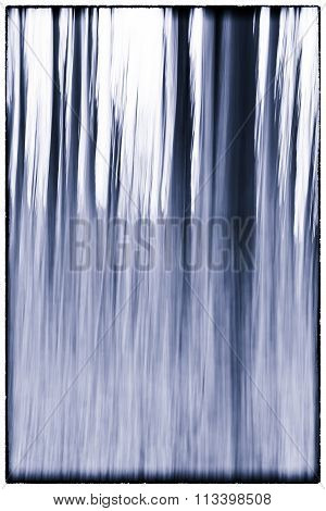 A Slow Shutter Speed Coloured Photo Of Trees In A Forest Showing Leaves And Trees With A Vintage Blu