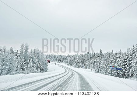 Truck In A Snow Covered Road To Kuolio In Finland On The Arctic Pole Circle