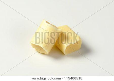 Two milk chewy candies on white background