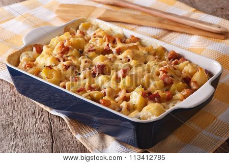 Tartiflette: Baked Potatoes With Bacon And Cheese Close Up