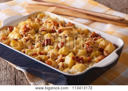 Tasty Potatoes With Bacon And Cheese Close Up. Horizontal