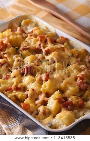 Potato With Bacon And Cheese Close Up In Baking Dish. Vertical