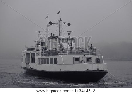 Ferry to Suomenlinna fortress island on foggy afternoon