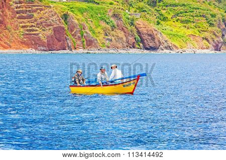 Fishermen On Yellow Motorboat Offshore Of Calheta, Madeira