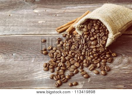 Coffee Beans Spilled Out Of The Canvas Sack