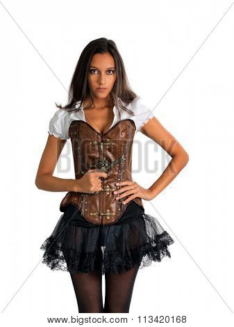 Three Quarter Length Portrait of Young Brunette Woman Wearing Old Fashioned Western Costume with Corset and Tutu Holding Antique Pistol and Standing in Studio with Hand on Hip in White Studio