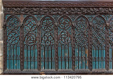 Architectural Detail of Blue Windows with Intricate Wood Carving Designs in Historical Santa Maria Gloriosa dei Frari Church Illuminated by Blue Light, Venice, Italy