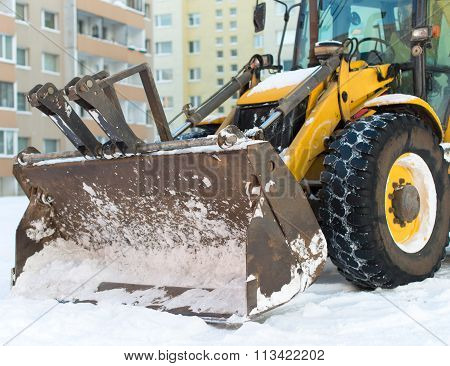 Tractor Is Ready To Clear Snow On The Street.