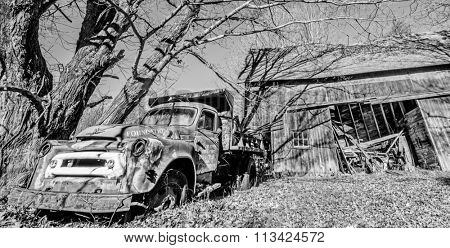 Monroe, CT, USA - Nov 3rd 2015: Vintage truck decaying outside a broken down barn in rural Connecticut, New England, USA