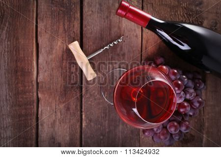 Grapes and wine on wooden background