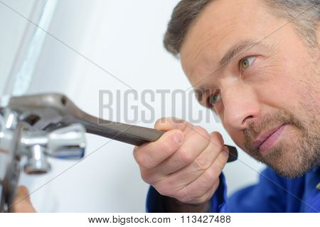 Plumber hard at work on a job