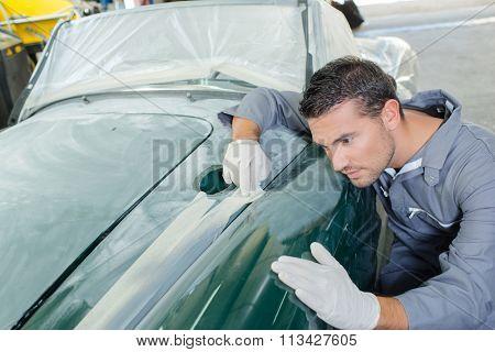 Sanding down a car