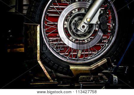 Motorcycle Wheel In Holder