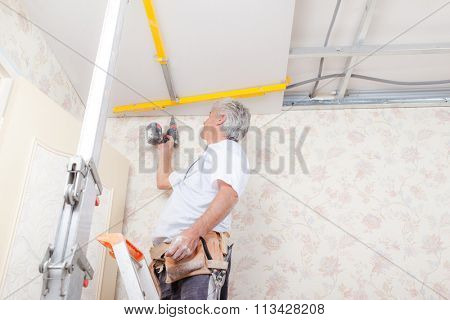 Builder working on ceiling