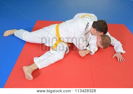 Two men on a judo mat