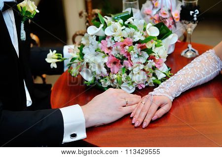 Wedding Couple Holding Hands On Bouquet. Groom And Bride In A Park. Wedding Dress. Bridal Wedding Bo