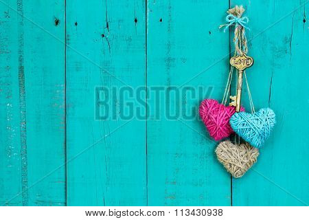 Skeleton key and hearts hanging on rustic door