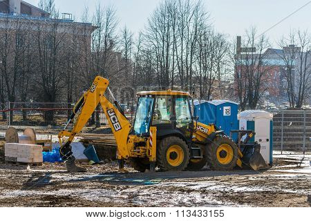 Wheel loader excavator stays at construction site