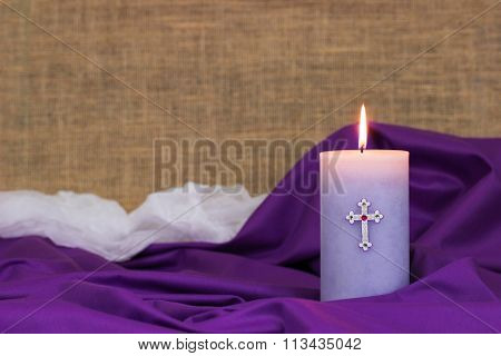 Easter candle on purple cloth