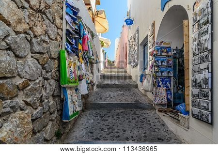 Trading street with different souvenirs at Thira town on Santorini island