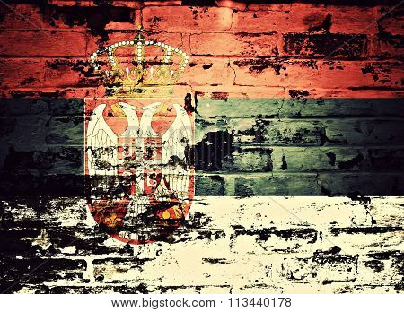 flag of Serbia painted on brick wall