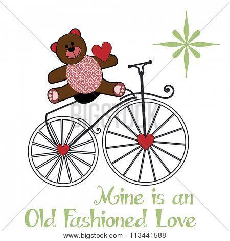 Valentine teddy-bear sitting on an old fashion bike - heart pattern on its tummy