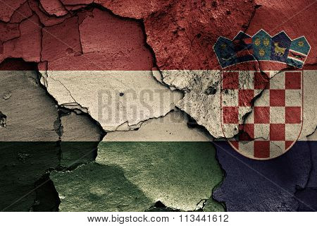 Flags Of Hungary And Croatia Painted On Cracked Wall