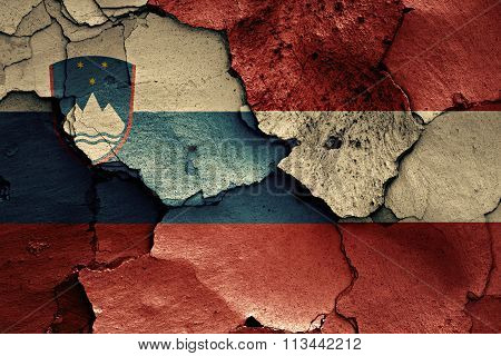Flags Of Slovenia And Austria Painted On Cracked Wall