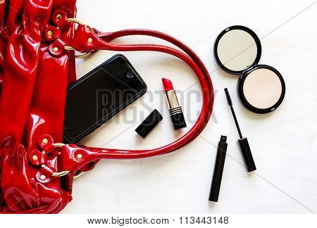 Women's Set Of Fashion Accessories On Wooden Background: Shoes, Handbag, Cell Phone And Cosmetics