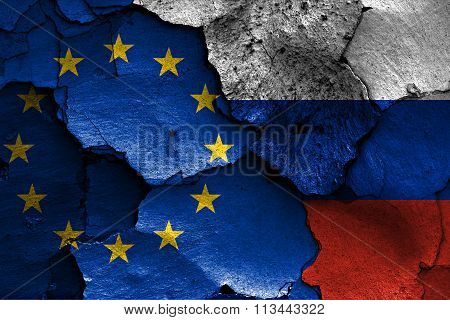 Flags Of European Union And Russia Painted On Cracked Wall