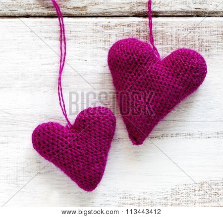 Crochet Pink Hearts On Wooden Background