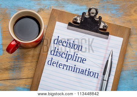 Decision, discipline, and determination words  on a clipboard with a cup of coffee - motivational tips for achieving goals and success