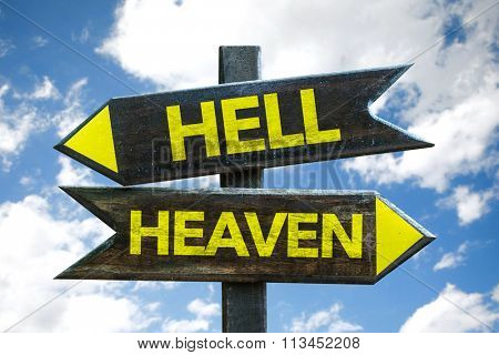 Hell - Heaven signpost with sky background