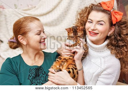 Mother, Daughter And A Cat. Pet.