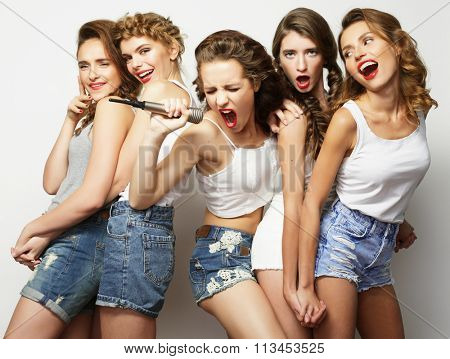 beautiful stylish hipster  girls singing karaoke