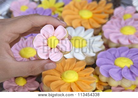 Flower sugar cookies decorated with royal icing by hand