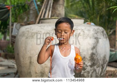 Children playing with soap bubbles, Boy with Bubbles
