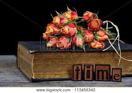orange roses on old book