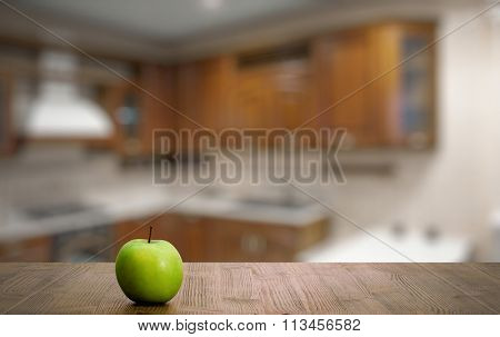 green apple on old wooden table in the kitchen
