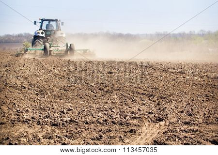 Backside Cultivator Raises Great Dust On Ploughed Soil
