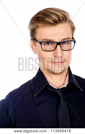 Confident young man in spectacles looking at camera and slightly smiling. Isolated over white.