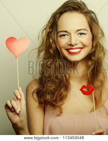Playful young women holding a party heart