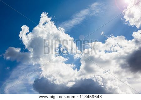 Beautiful Light Blue Sky With Puffy White Clouds And Sunlight