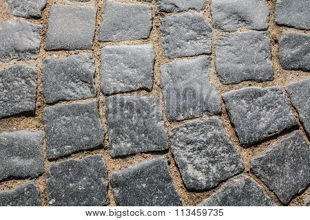 Royal ancient paving.  Sidewalk street paved with ancient cobblestones.