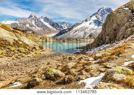 Lac Blanc And And Mountain Range - France