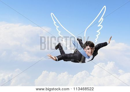 Businessman flying high